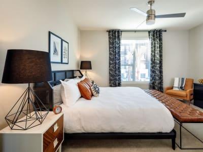 Naturally lit model bedroom at Latitude at Presidio in Cedar Park, Texas