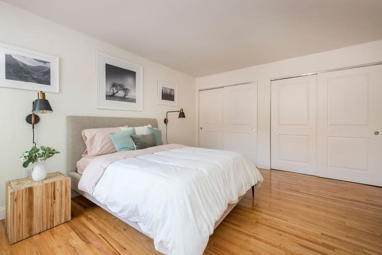 Everly Roseland model bedroom with beautiful white bed in Roseland, New Jersey