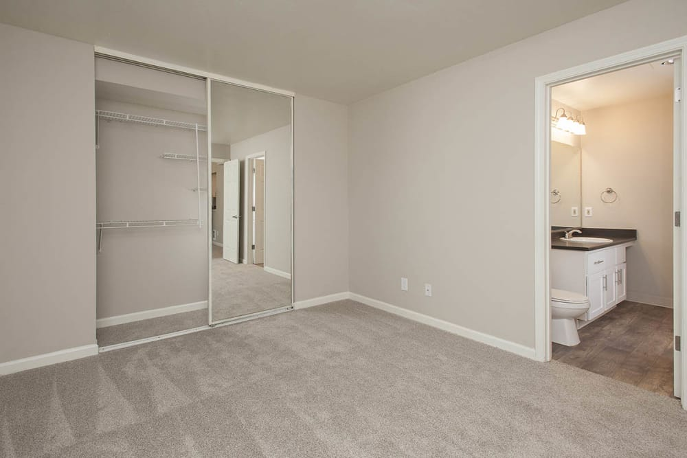 Bedroom featuring walk-in closet and bathroom at Waterhouse Place in Beaverton, Oregon