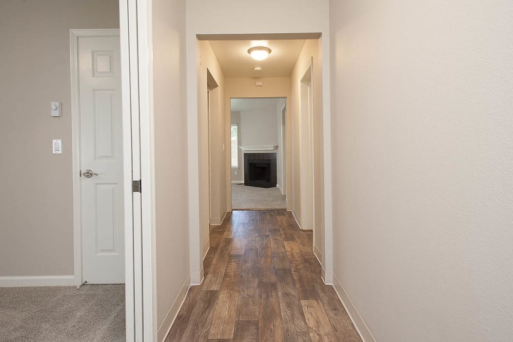 Hallway with wooden flooring at Waterhouse Place in Beaverton, Oregon
