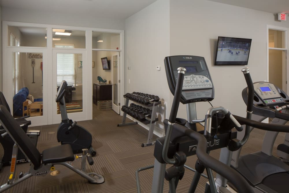 Fitness room at West Woods Apartments in Pensacola, Florida