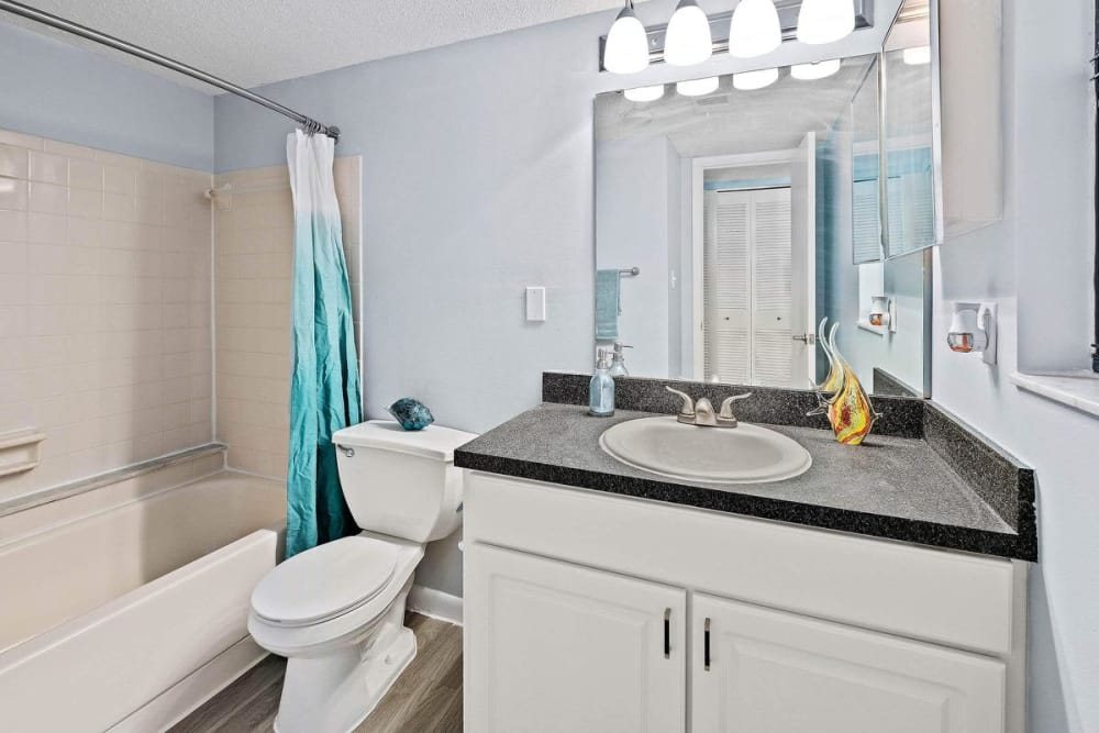WestEnd At 76Ten model bathroom with white finishes in Tampa, Florida