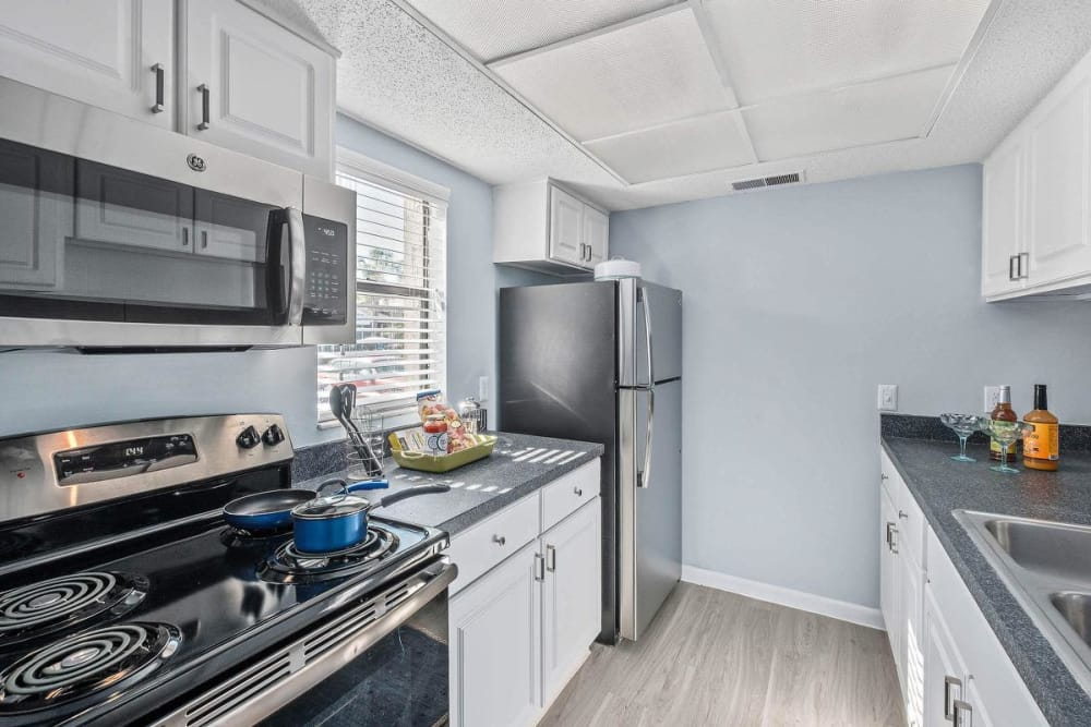 Model kitchen featuring beautiful modern appliances at WestEnd At 76Ten in Tampa, Florida