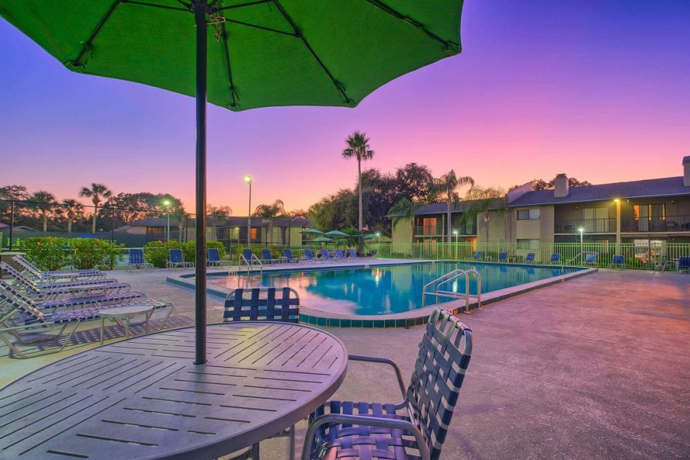 Sunset view of swimming pool outside of WestEnd At 76Ten in Tampa, Florida