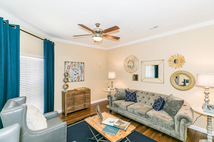 Modern decor in the spacious living room of a model home at Hilltops in Conroe, Texas