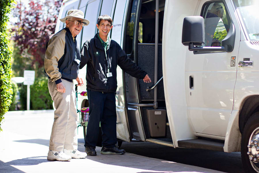 Staff and resident boarding a shuttle at Palo Alto Commons in Palo Alto, California