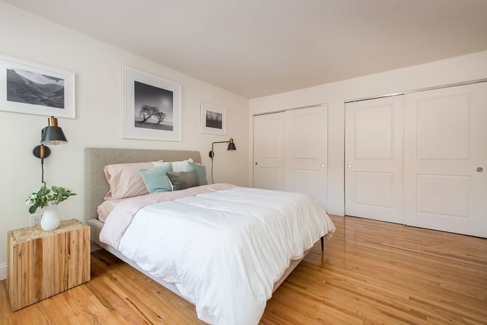 Model bedroom with wonderful wood flooring at Everly Roseland in Roseland, New Jersey