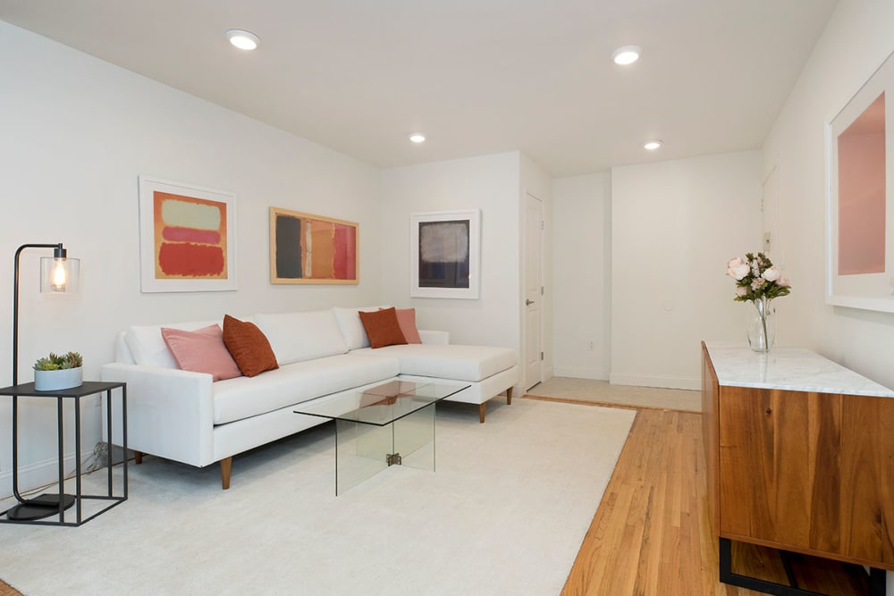 Model living room with tasteful white rug at Everly Roseland in Roseland, New Jersey