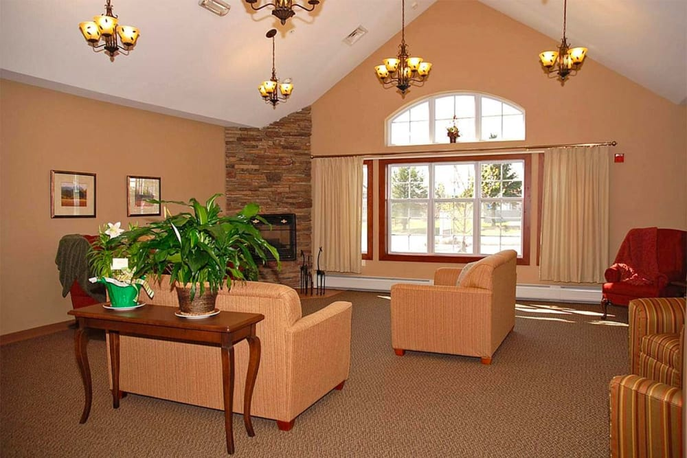 Comfortable seating area with large windows at Milestone Senior Living in Eau Claire, Wisconsin.