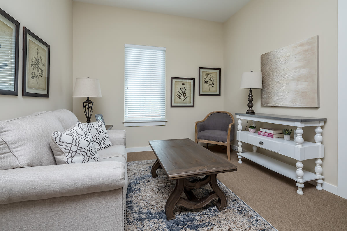 A spacious resident living room at The Claiborne at West Lake in Martinez, Georgia.