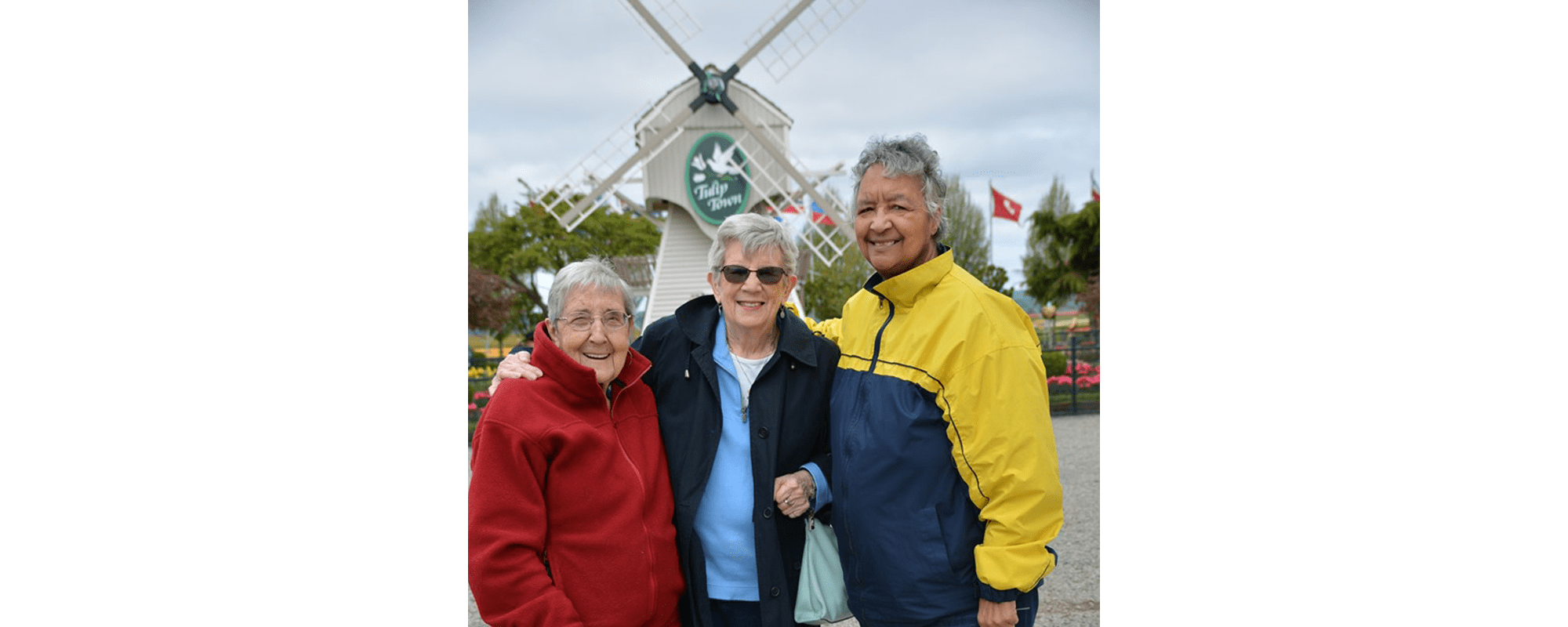 Group photo in front of Tulip Town at Mountlake Terrace Plaza in Mountlake Terrace, Washington