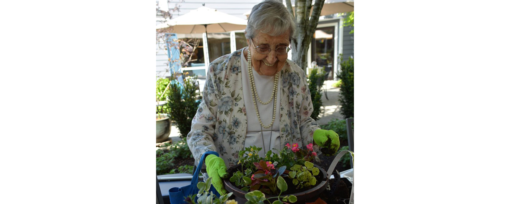Woman gardening at Mountlake Terrace Plaza in Mountlake Terrace, Washington