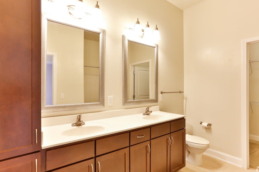 Bathroom with double sinks at Fountains at Mooresville Town Square in Mooresville, North Carolina