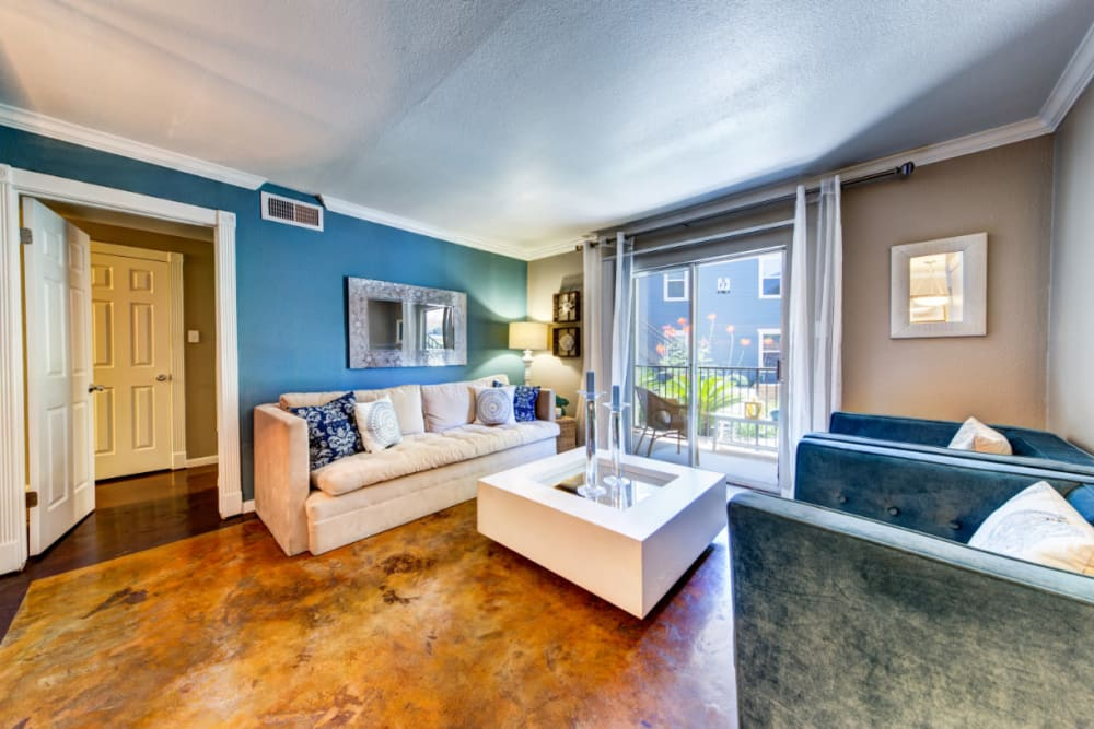 Bright and open living room with access to private balcony seating area at Austin Midtown in Austin, Texas