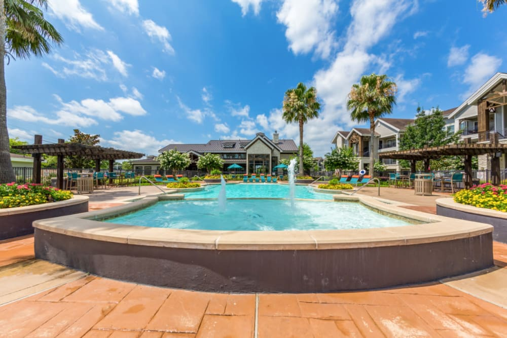 Water feature overlooking pool and clubhouse at Marquis at Sugar Land in Sugar Land, Texas