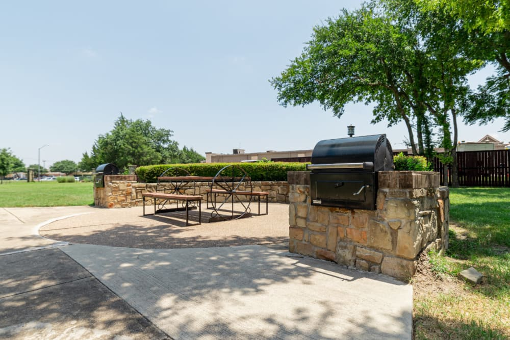 Outdoor BBQ with seating area at Marquis at Bellaire Ranch in Fort Worth, Texas