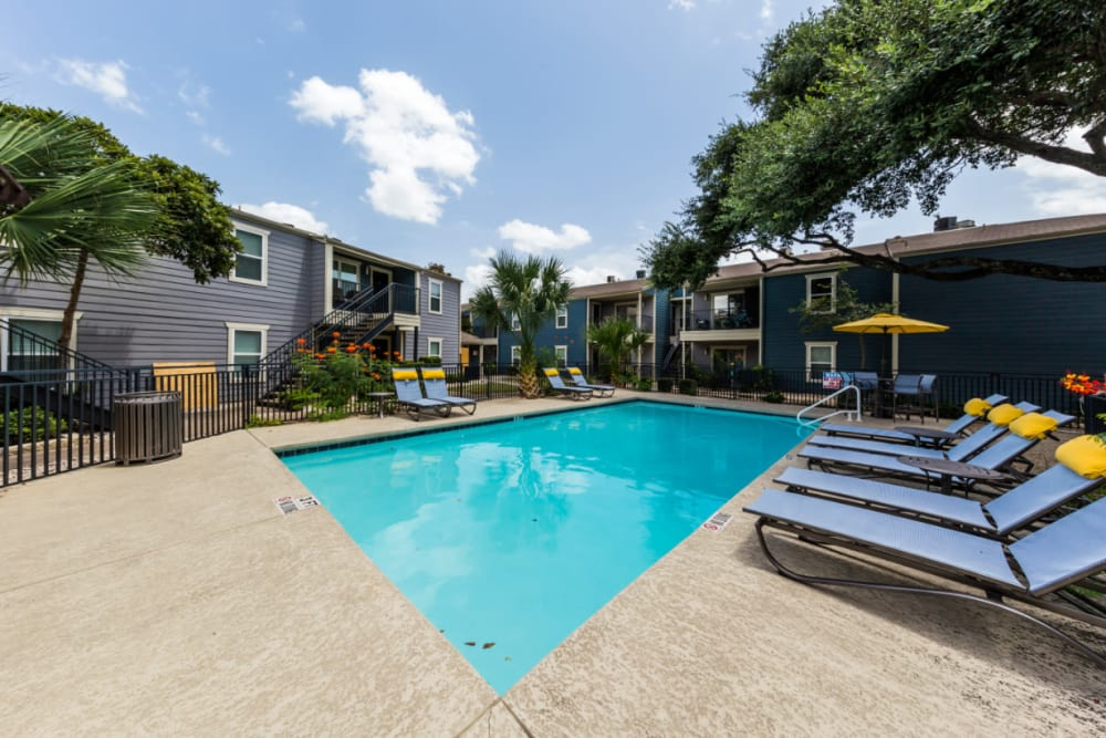 Smaller pool surrounded by lounge chairs at Austin Midtown in Austin, Texas