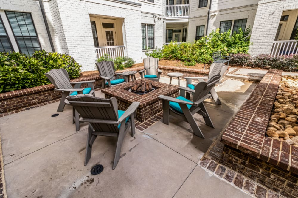 Brick firepit with chairs and cushions at Marquis at Buckhead in Atlanta, Georgia