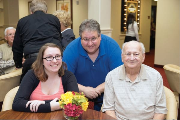 Frank Gordon with his son and daughter at Ashton Gardens Gracious Retirement Living in Portland, Maine