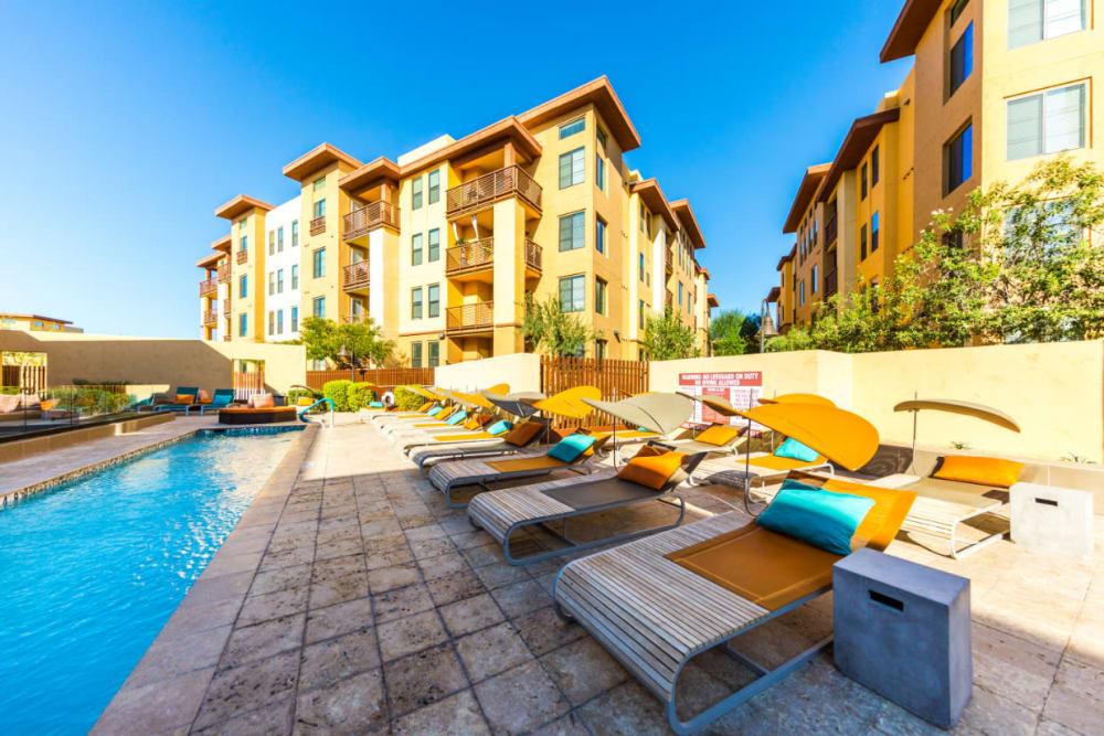 Swim lane surrounded by lounge chairs at Marquis at Desert Ridge in Phoenix, Arizona