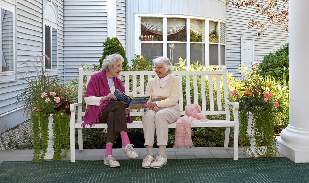 Friends on a bench at Equinox Terrace in Manchester Center, Vermont