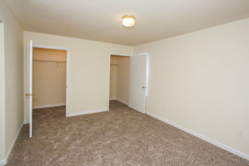 An apartment bedroom with two closets at Oconee Springs Apartments in Gainesville, Georgia