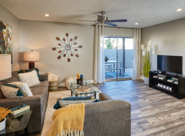 Beautifully decorated living space with hardwood floors in one of Fort Family Investments's corporate housing units in Jacksonville, Florida
