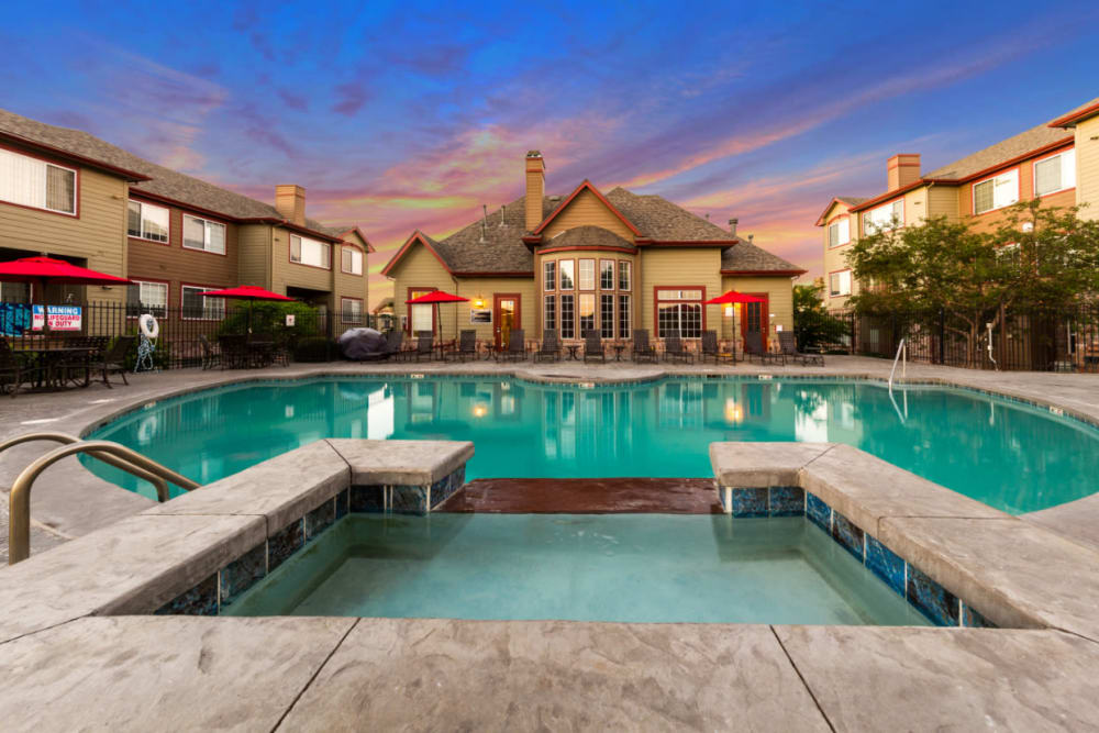 Resort-style swimming pool with heated spa at The Links at Plum Creek in Castle Rock, Colorado