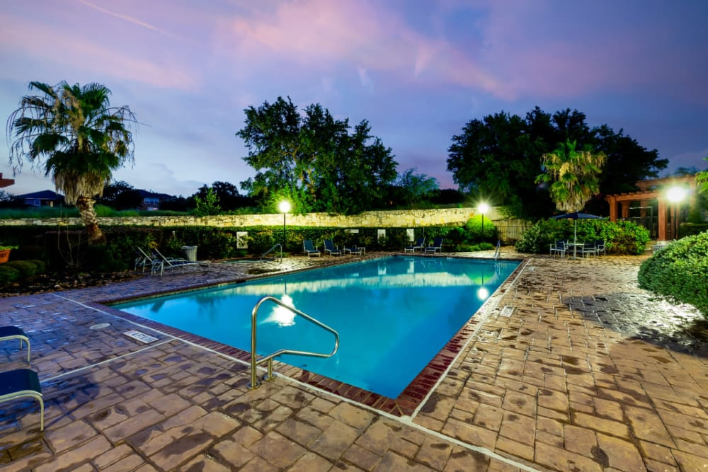 Lighted pool at sunset at Marquis at Stone Oak in San Antonio, Texas