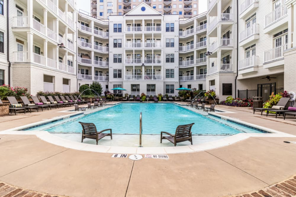 Sparkling resort style pool with chairs in shallow area at Marquis at Buckhead in Atlanta, Georgia