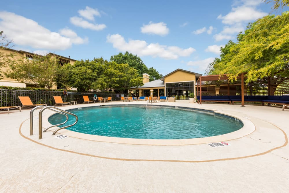 Round pool with lounge chairs and gazebo at Marquis at Barton Trails in Austin, Texas