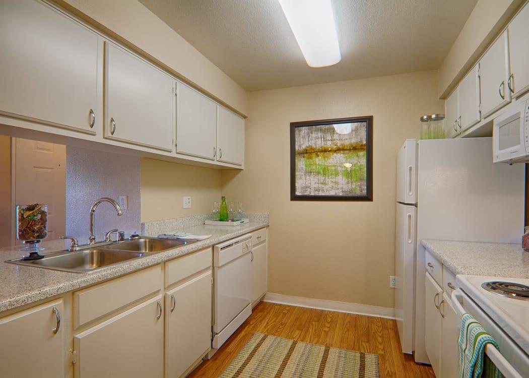 Kitchen with white cabinets at Granada Villas Apartment Homes in Lancaster, California