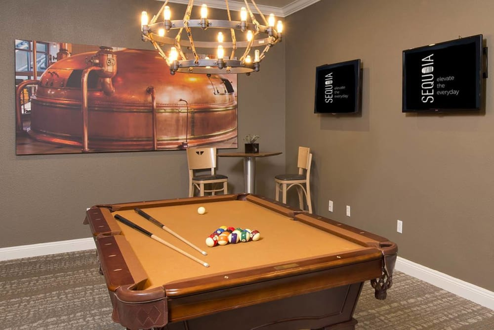 Billiards room with high-top tables and chairs at River Oaks Apartment Homes in Vacaville, California