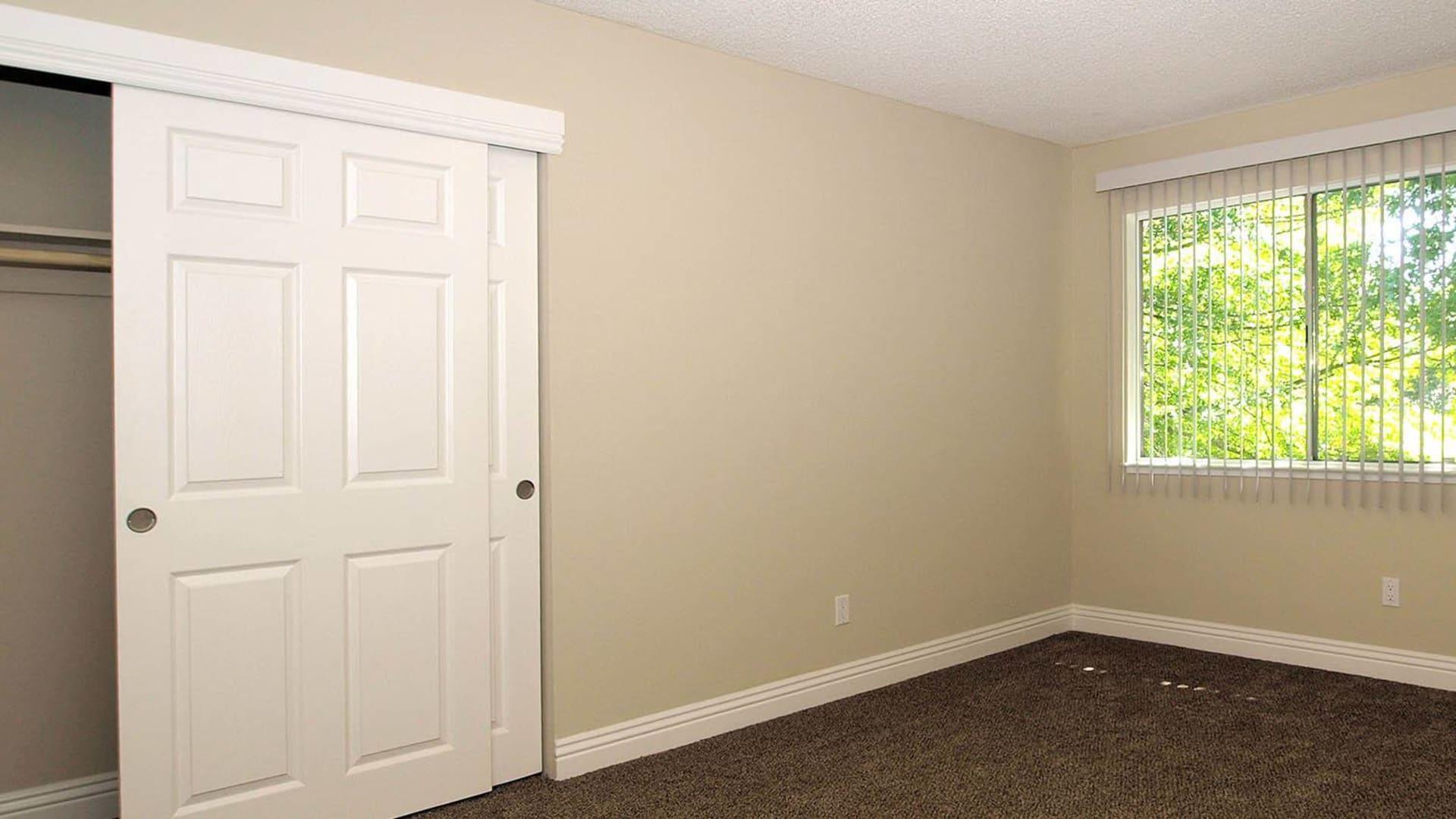 Bedroom and closet at Spring Lake Apartment Homes in Santa Rosa, California