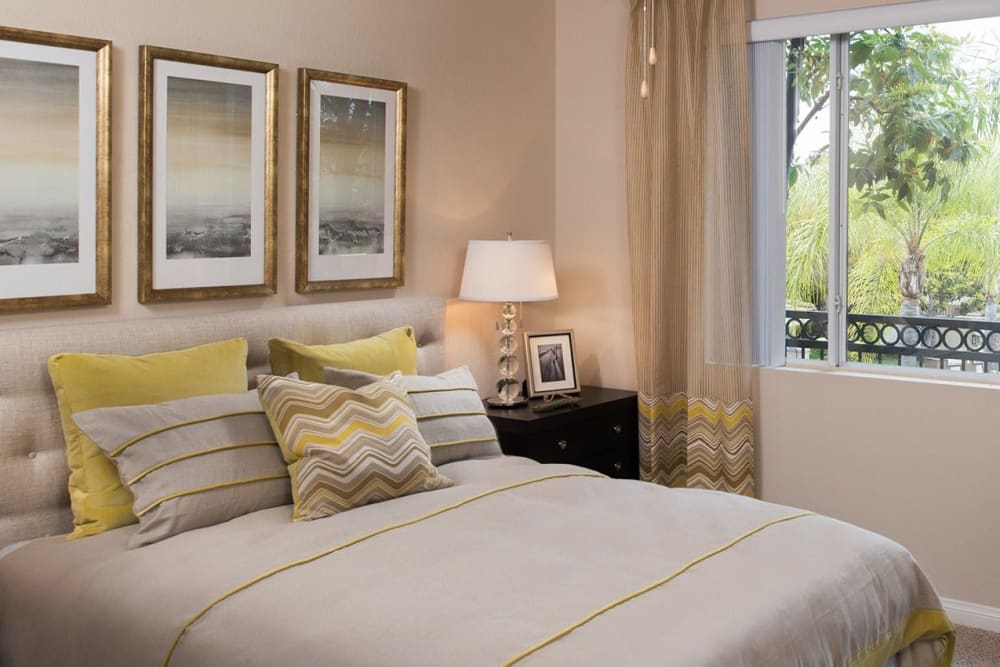 Main bedroom with a large window at Alize at Aliso Viejo Apartment Homes in Aliso Viejo, California