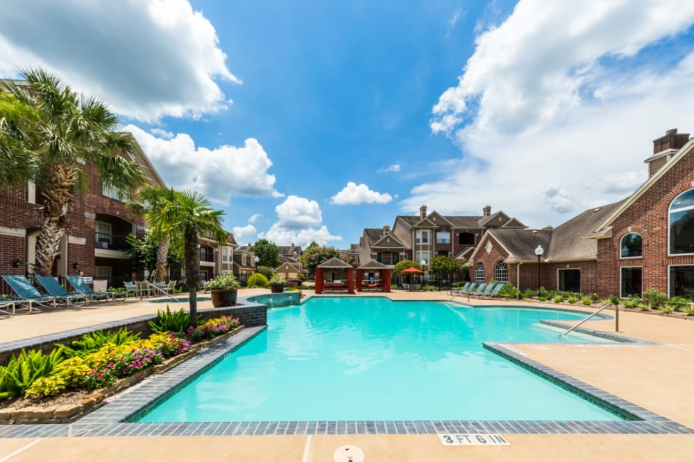 Sparkling pool with water features overlooking gazebos at Marquis on Park Row in Houston, Texas