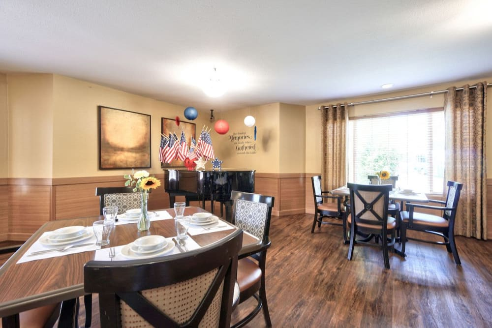 Beautiful dining room with a piano at Regency Park Place at Corvallis in Corvallis, OR.