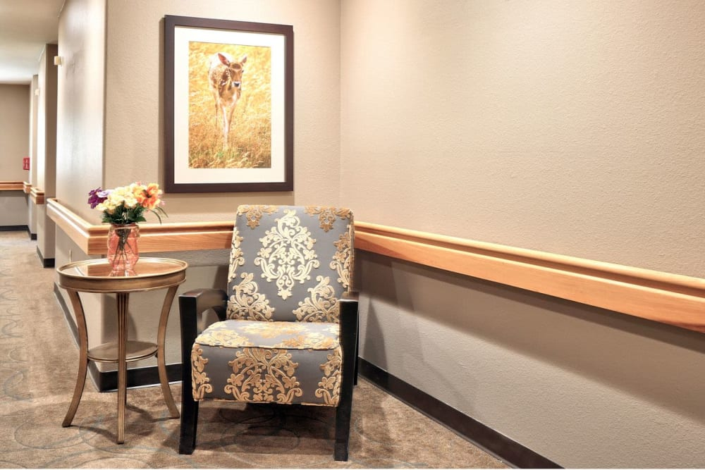 Hallway with chairs at Regency Park Place at Corvallis in Corvallis, OR.