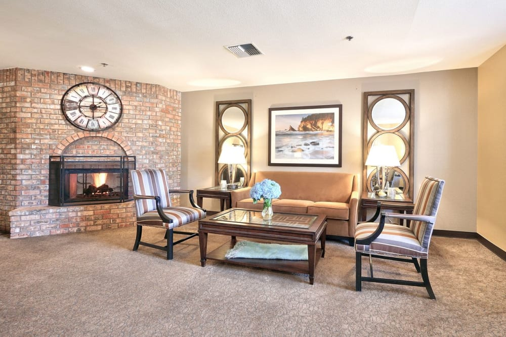 Spacious living room with a fireplace at Regency Park Place at Corvallis in Corvallis, OR.