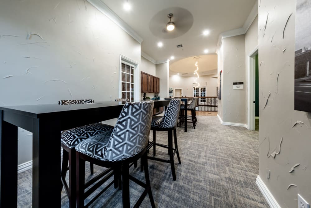 Community clubhouse dining area with multiple tables and chairs at Marquis at Stone Oak in San Antonio, Texas