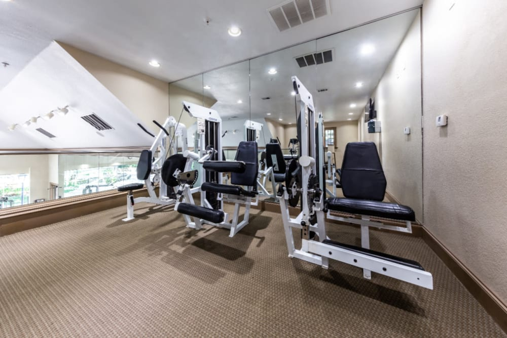 Weight assisted machines in upstairs section of fitness room at Marquis at Waterview in Richardson, Texas