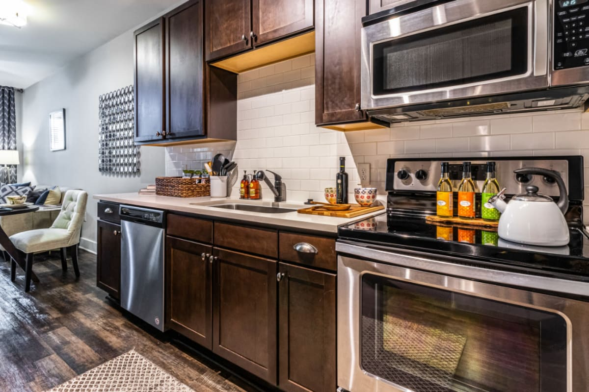Bright kitchen with wood cabinets and stainless steel appliances at Marquis at Buckhead in Atlanta, Georgia