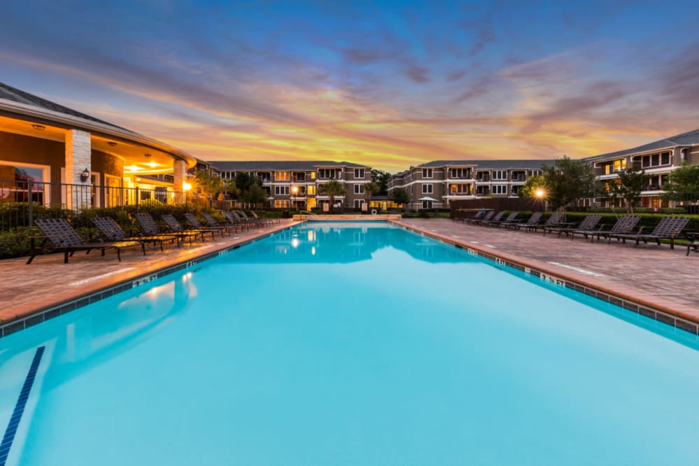 Sparkling pool at sunset at Marquis at The Cascades in Tyler, Texas