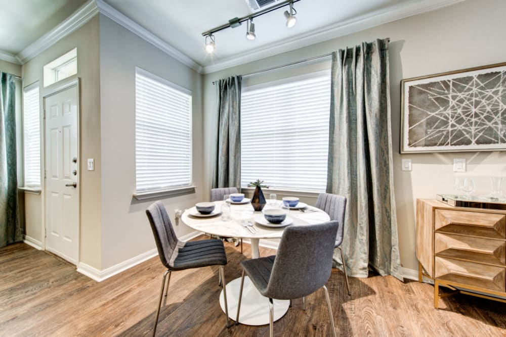 Dining room with wood style flooring at Marquis at Cinco Ranch in Katy, Texas