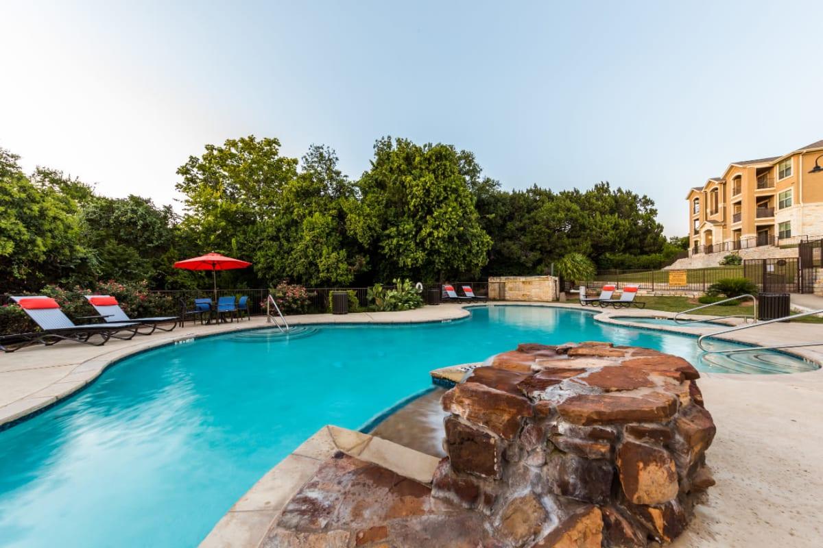 Resort-style swimming pool at Marquis at Canyon Ridge in Austin, Texas