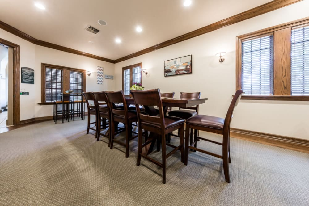 Community clubhouse large dining table at Marquis at Waterview in Richardson, Texas