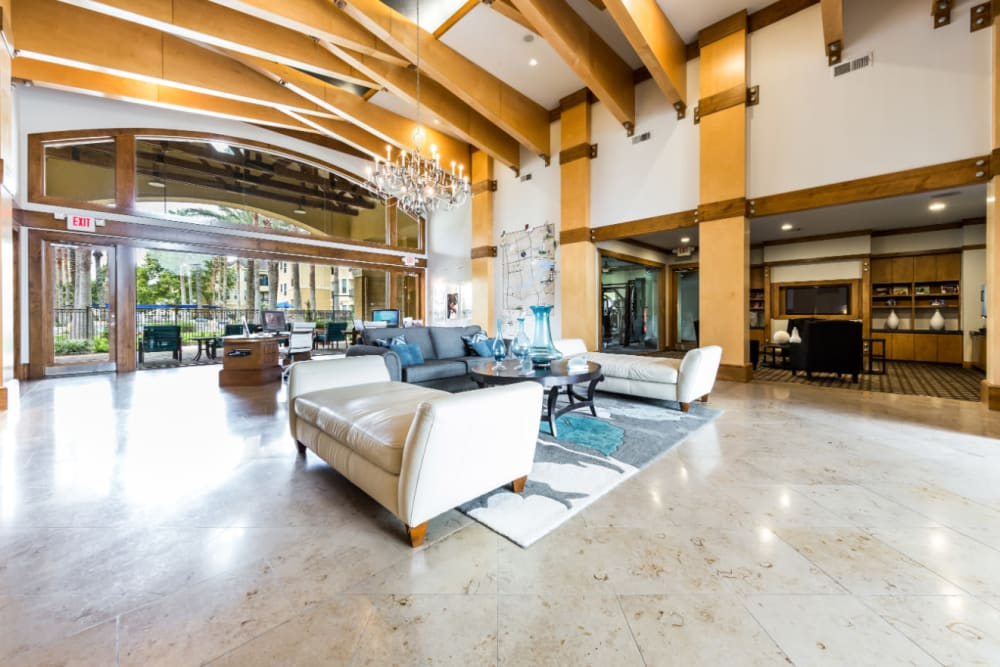 Community clubhouse lobby sitting area with view of the pool at Marquis at Clear Lake in Webster, Texas