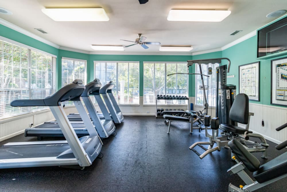 Treadmills and weight machines in fitness room at Marquis of Carmel Valley in Charlotte, North Carolina