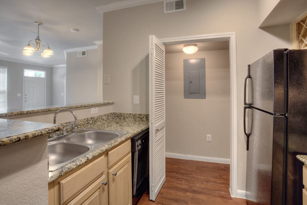 Kitchen with walk-in pantry at Marquis Bandera in San Antonio, Texas