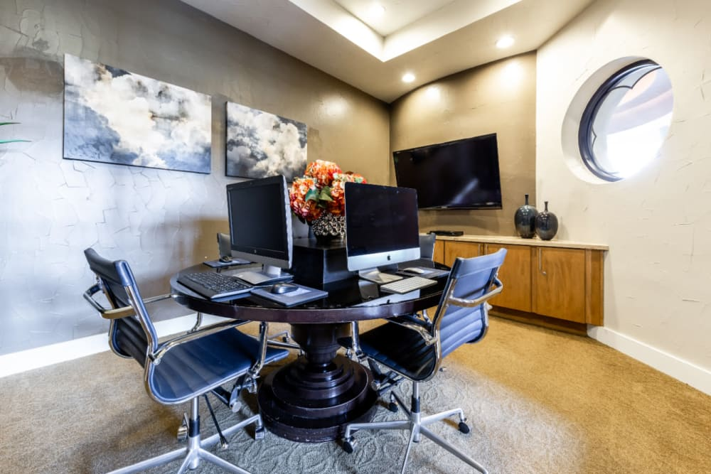 Executive business center with multiple work stations at Marquis at the Reserve in Katy, Texas